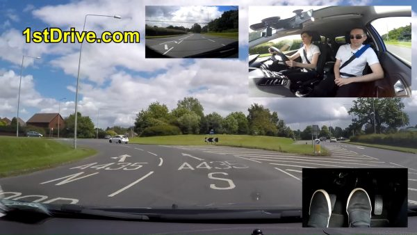 Birmingham driving school lesson in which Lucy learns how to drive around a multi lane high speed roundabout